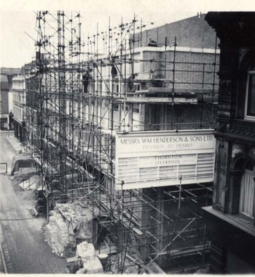 Rebuilding William Henderson & Sons after fire, 1962.